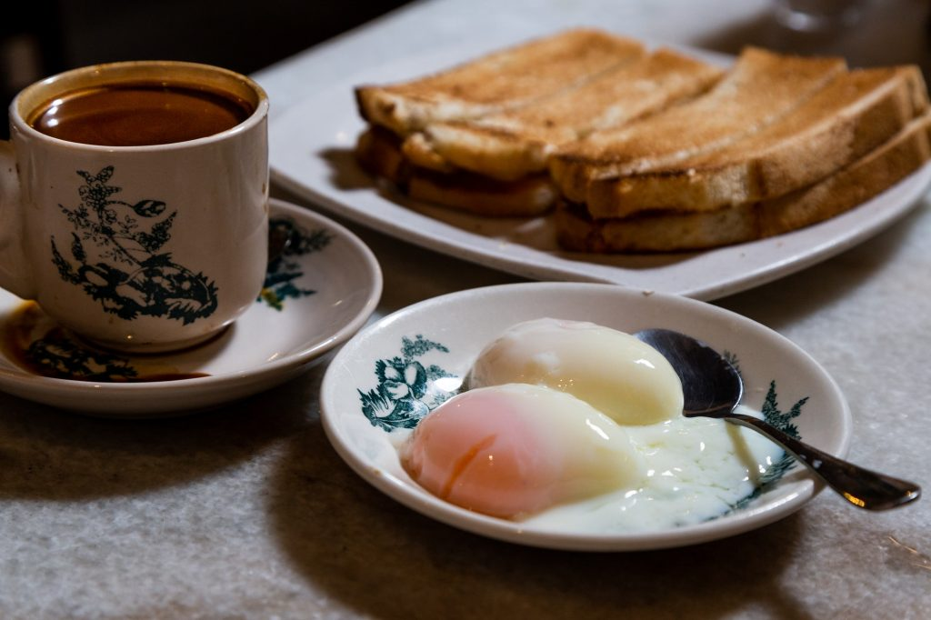 Half boiled eggs, coffee, toast bread, popular Chinese style breakfast in Malaysia